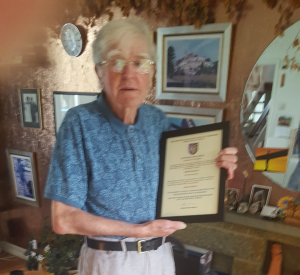 Bro Hall receives 60 years certificate